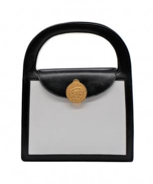 サークルプレートバイカラーハンドバッグ
